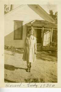 My grandma in front of her one-room schoolhouse